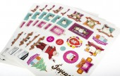 A4 sheets of stickers, of variable shape and size, kiss cut so the individual sticker can be removed easily.